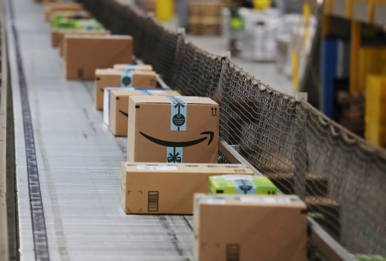 Image: Packaged merchandise is seen on a conveyer belt at the Amazon fulfillment center in Robbinsville