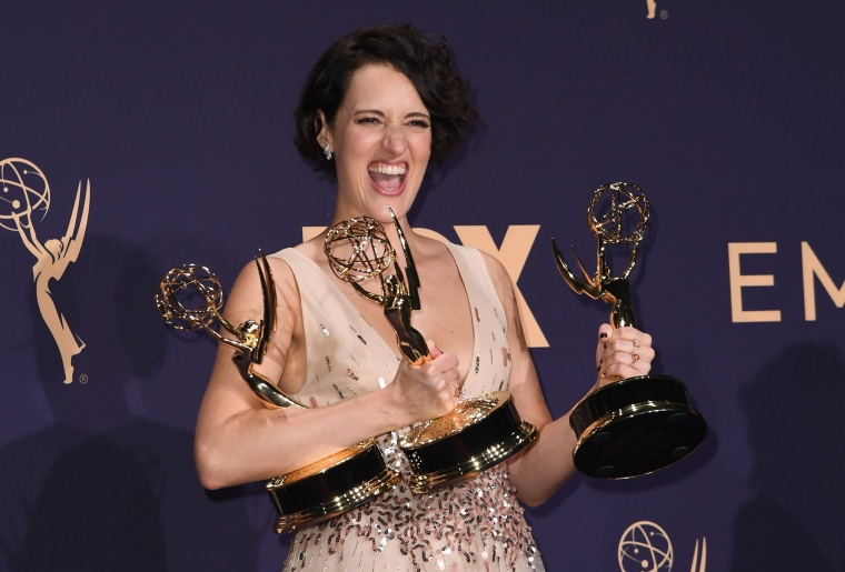 """Image: British actress Phoebe Waller-Bridge poses with the Emmy for Outstanding Writing for a Comedy Series, Outstanding Lead Actress In A Comedy Series and Outstanding Comedy Series for """"Fleabag"""" during the 71st Emmy Awards at the Microsoft Theatre in Lo"""