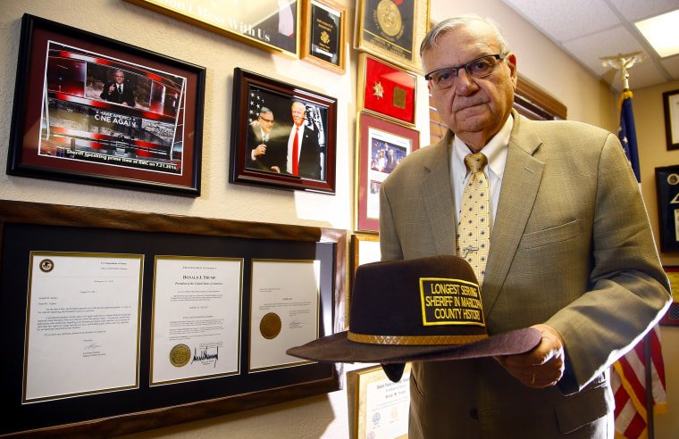 Image: Former Maricopa County Sheriff Joe Arpaio in Fountain Hills, Ariz., on Aug. 26, 2019. Arpaio stands next to his presidential pardon from President Donald Trump.