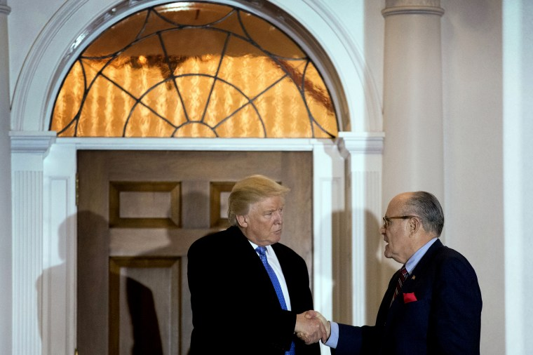 Image: President-elect Donald Trump and Rudy Giuliani shake hands following a meeting at Trump International Golf Club in Bedminster, N.J., on Nov. 20, 2016.