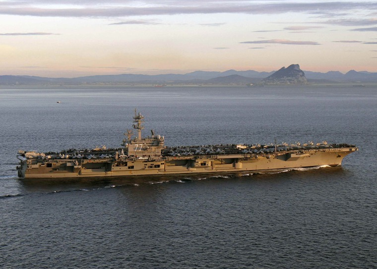Image: The aircraft carrier USS George H.W. Bush transiting the Strait of Gibraltar into the Mediterranean Sea