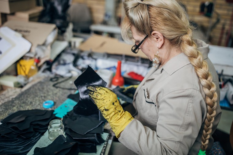 Mature woman working in shoe factory