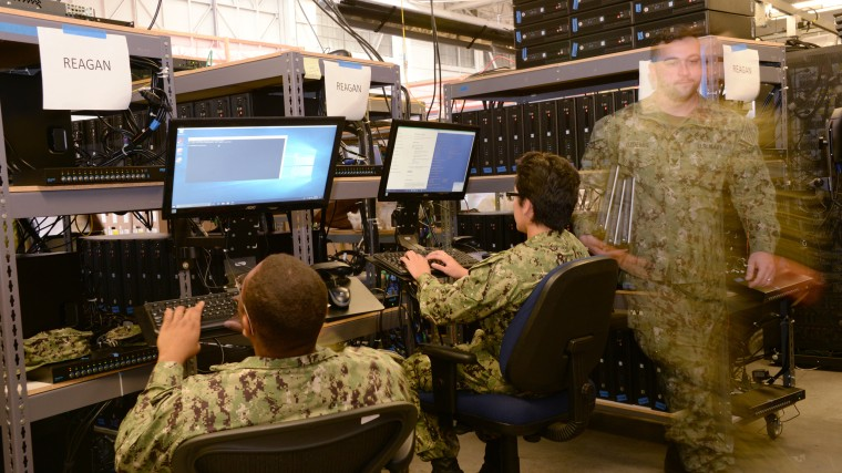 U.S. Navy Information Systems technicians work in San Diego.