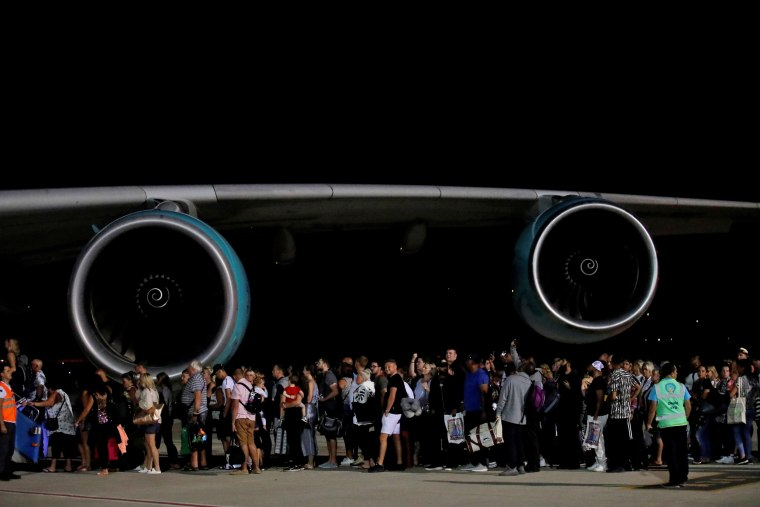 Image: British passengers board an Airbus A380 airliner that is being used for transporting Thomas Cook customers at Dalaman Airport