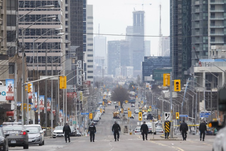 Image: Police officers sweep Yonge St. on April 24, 2018 in Toronto, Canada.