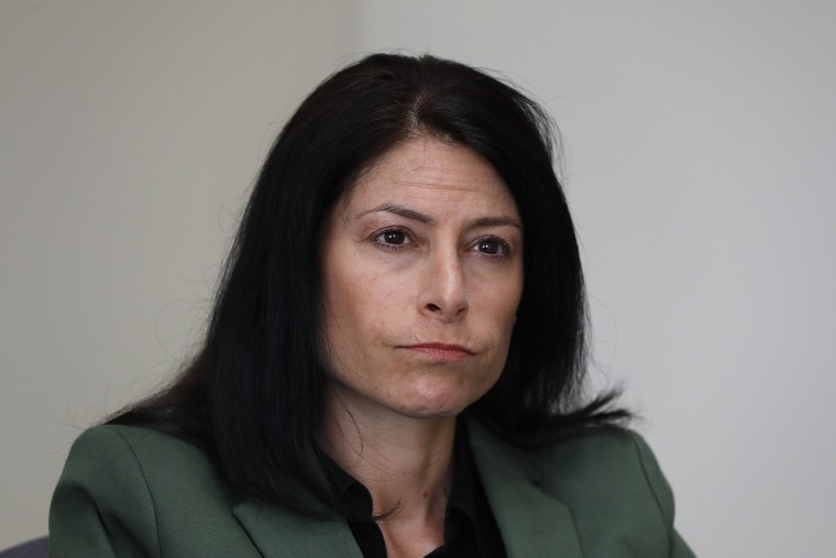 Image: Dana Nessel, Attorney General of Michigan, listens to a question from reporters in Detroit.