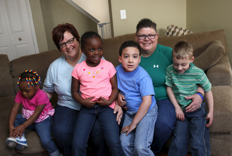 Image: Michigan couple DeBoer and Rowse pose with their children in their home in Hazel Park