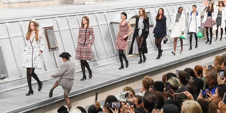 A spectator from the audience climbs the runway to walk with the models during the finale of the Chanel  Spring/Summer 2020 show as part of Paris Fashion Week on October 1, 2019 in Paris, France.