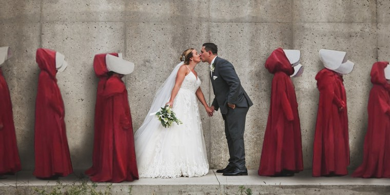 """A bride and groom pose for their wedding photo in front of the """"hanging wall"""" from the Hulu series """"The Handmaid's Tale"""" in Cambridge, Ontario, Canada. The photo was digitally altered to include characters from the popular series."""