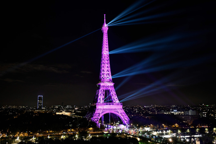 """A picture taken on October 1, 2019 shows the Eiffel tower illuminated in pink to mark the start of \""""Octobre Rose\"""" (Pink October) or Breast Cancer Awareness Month in Paris."""