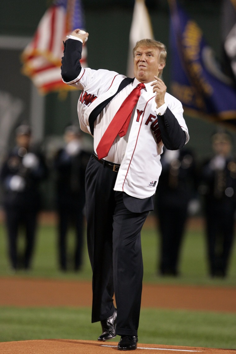 Image: Trump throws the first pitch before the start of the second game between the Boston Red Sox and New York Yankees