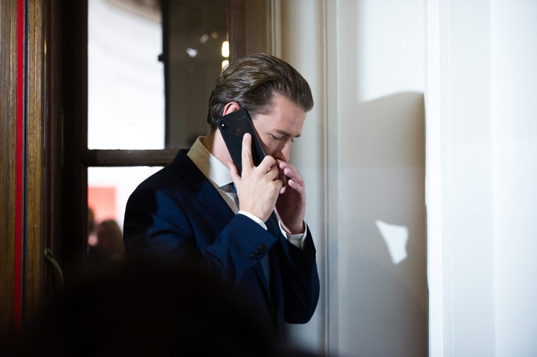 Image: Former Chancellor Sebastian Kurz of the Austrian People's Party (OeVP) talks on the phone at Hofburg before a television interview following elections to the National Council