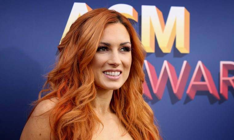 Image: Becky Lynch arrives at the Academy of Country Music Awards in Las Vegas on April 15, 2018.