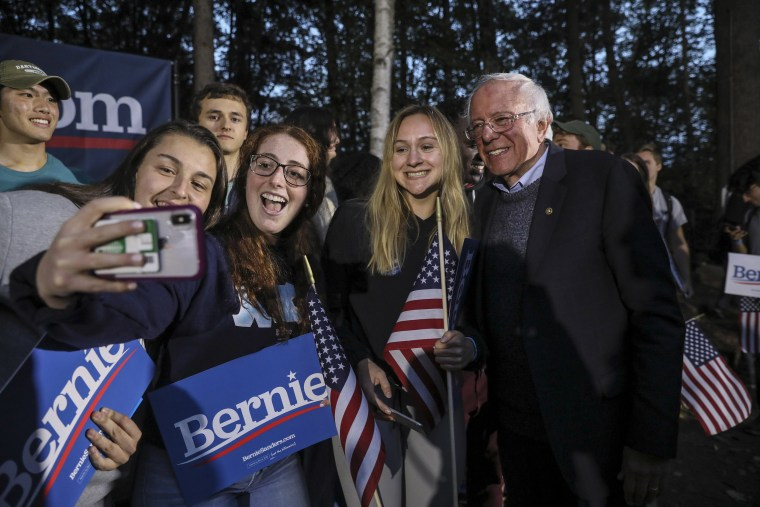 Image: Democratic presidential candidate Sen. Bernie Sanders, I-Vt., takes a selfie with students after speaking at a campaign event,