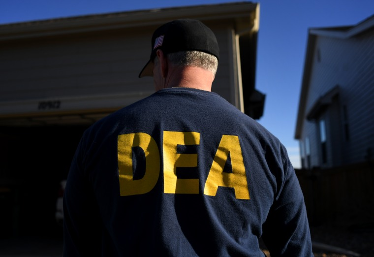 Image: A Drug Enforcement Administration officer during a home raid in Colorado on Jan. 31, 2019.