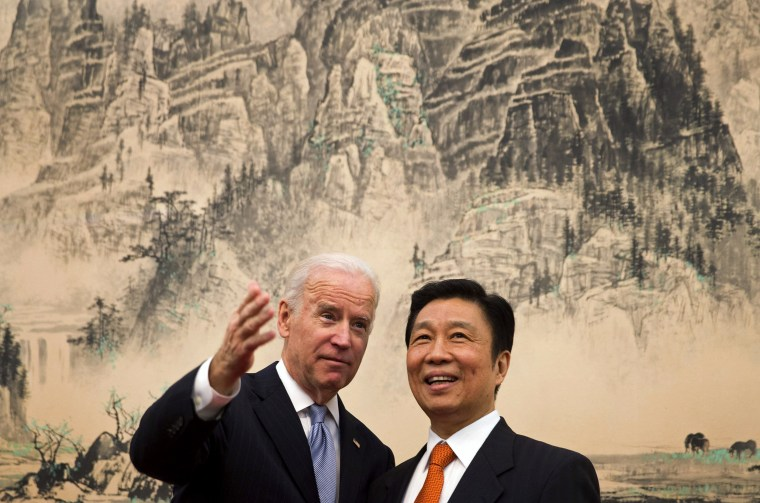 IMage: Vice President Joe Biden speaks with Chinese Vice Premier Li Yuanchao before a lunch in Beijing on Dec. 5, 2013.