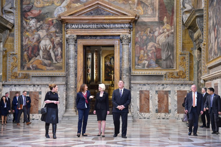 Image: Secretary of State Mike Pompeo, his wife Susan and Ambassador to the Holy See, Callista Gingrich listen to a curator as they visit the Sala Regia state hall in the Vatican
