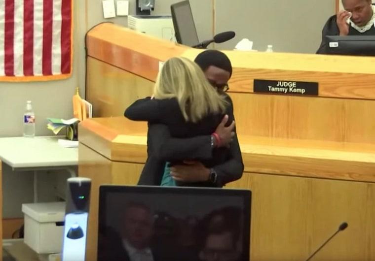 Brandt Jean hugs Amber Guyger at her sentencing on Wednesday.