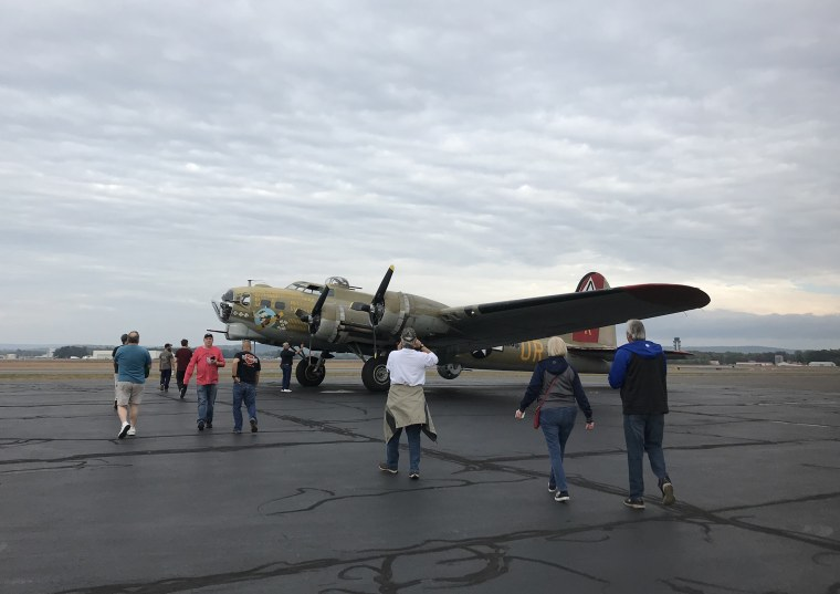Rob Riddell, left in blue shirt, boards a Boeing B-17 at the Bradley International Airport, just outside Hartford, Conn., on Oct. 2, 2019.