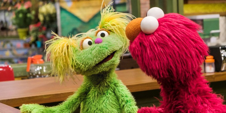 "Karli and Elmo talk about her mom's ""grown up problem."""