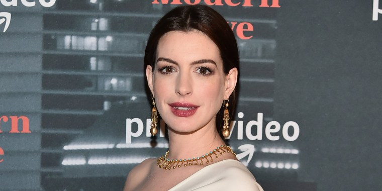 Pregnant Anne Hathaway glows in stunning white ensemble at 'Modern Love' premiere