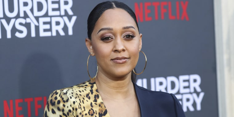 WESTWOOD, LOS ANGELES, CALIFORNIA, USA - JUNE 10: Actress Tia Mowry-Hardrict arrives at the Los Angeles Premiere Of Netflix's 'Murder Mystery' held at the Regency Village Theatre on June 10, 2019 in Westwood, Los Angeles, California, United States. (Photo by Xavier Collin/Image Press Agency/Sipa USA)(Sipa via AP Images)