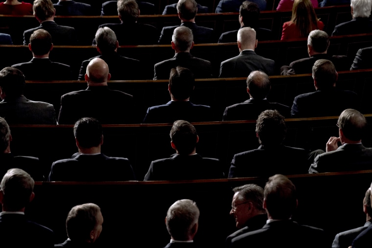 Image: Members of Congress listen as President Donald Trump delivers the State of the Union address at the Capitol on Jan. 30, 2018.
