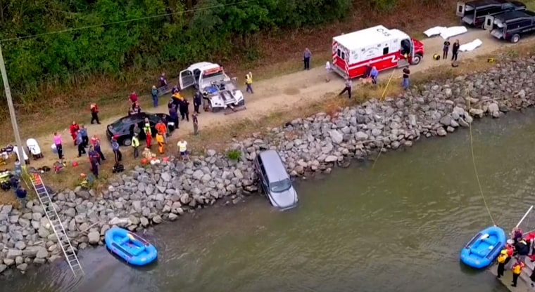 Image: Rescue crews remove a car that plunged into the Chesapeake and Delaware Canal in Middletown, Delaware, on Sunday morning.