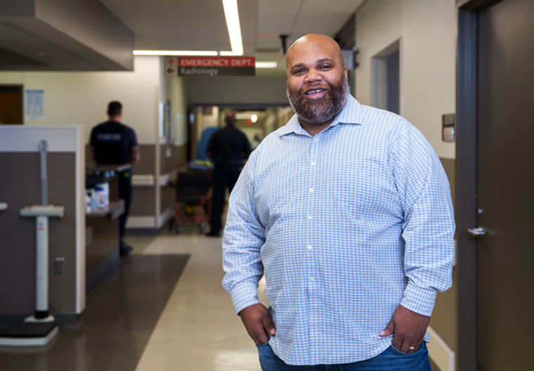 Image: Violence Intervention Specialist Ray Winans on the Emergency Room floor at Sinai Grace Hospital.