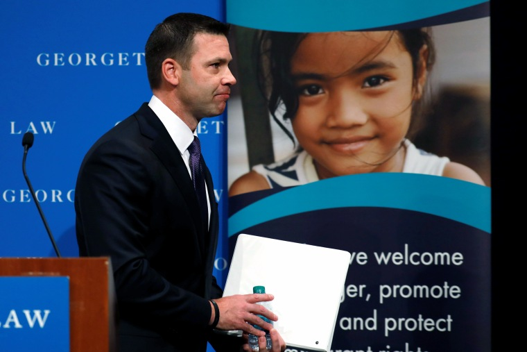 Image: Acting DHS Secretary Kevin McAleenan attends the Migration Policy Institute annual Immigration Law and Policy Conference