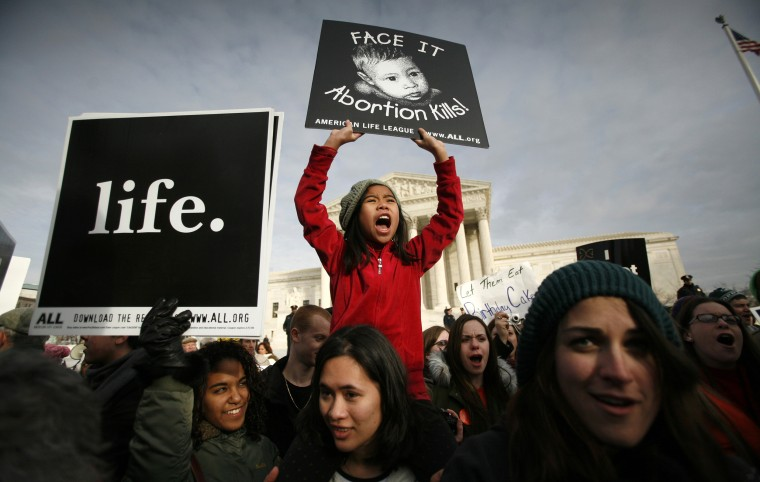 Anti-abortion protesters participate in the March for Life Fund's annual march marking the