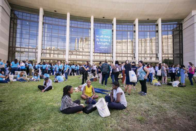 Attendees enjoy a break outside the convention center where the Grace Hopper Celebration was held.