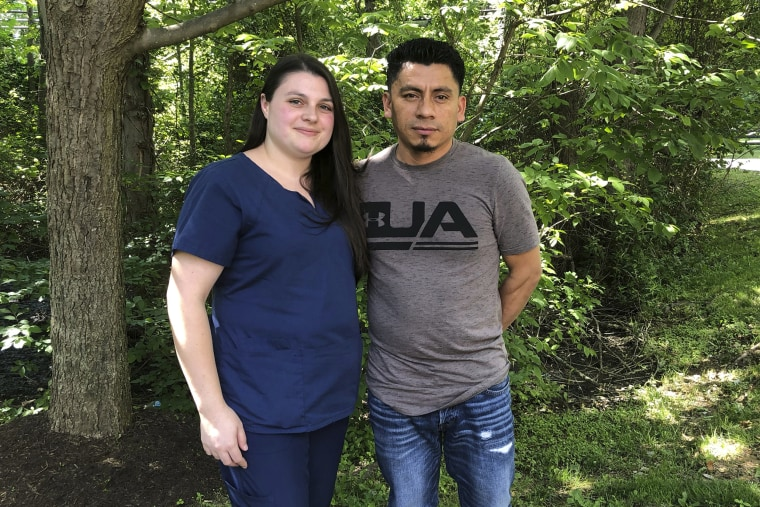 Image: Alyse Sanchez and her husband, Elmer Sanchez, pose for The Associated Press in Sandy Spring, Md.