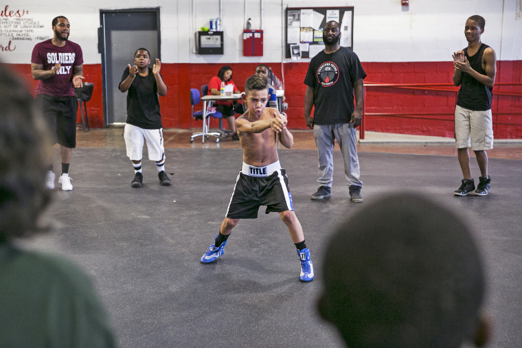 Khali Sweeney, center right, watches a student train at the Downtown Boxing Gym in Detroit.