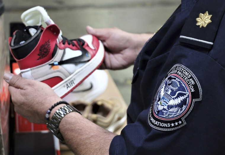 Image: More than 14,800 pair of counterfeit Nike shoes, seized in a shipment arriving from China at the Los Angeles-Long Beach sports complex