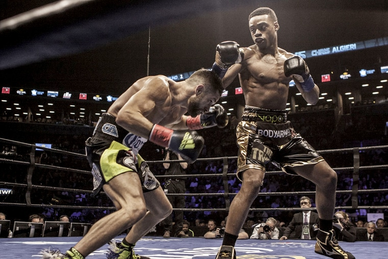Image: Errol Spence Jr., right, defeats Chris Algieri in a Welterweight fight at the Barclays Center in New York in 2016.
