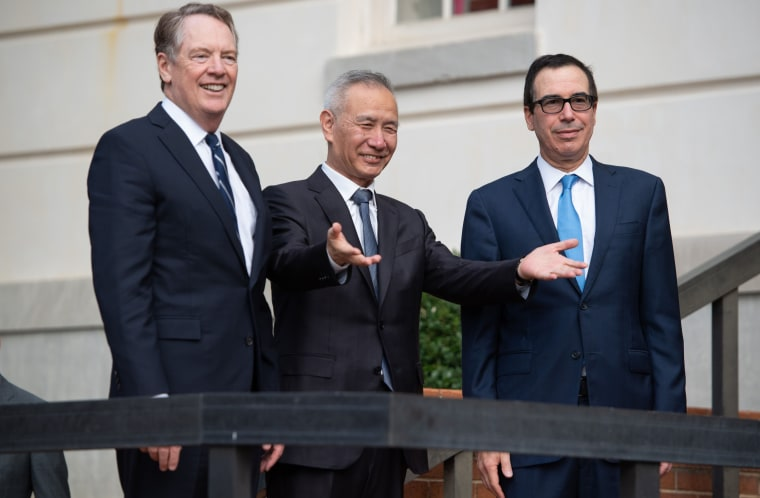 U.S. Trade Representative Robert Lighthizer, left, and Treasury Secretary Steven Mnuchin greet Chinese Vice Premier Liu He as he arrives for trade talks in Washington on Oct. 10, 2019.