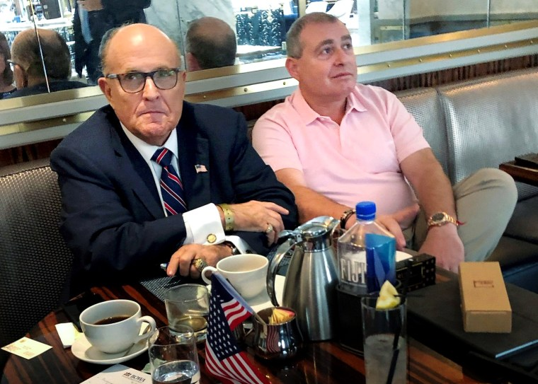 Image: Rudy Giuliani has coffee with Ukrainian-American businessman Lev Parnas at the Trump International Hotel in Washington on Sept. 20, 2019.