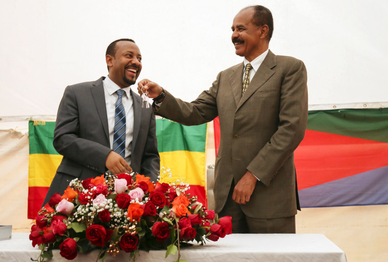 Image: Eritrea's President Isaias Afwerki receives a key from Ethiopia's Prime Minister Abiy Ahmed during the inauguration ceremony marking the reopening of the Eritrean Embassy in Addis Ababa