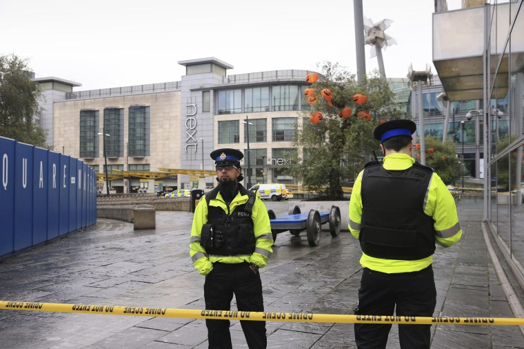 Police outside the Arndale Centre in Manchester, England, on Friday after a stabbing incident at the shopping center.