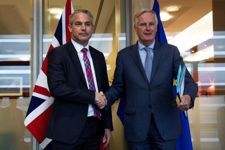 Britain's Brexit Secretary Barclay poses with EU's chief Brexit negotiator Barnier in Brussels