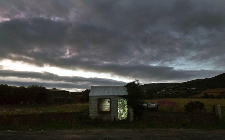 Image: A former customs guard hut is illuminated on the Irish border on Aug. 23, 2018 in Ravensdale, Ireland.