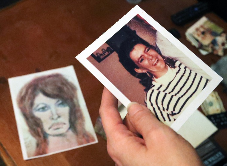 Image: Tonya Maslar holds a photographer of her mother, Roberta Tandarich, on Oct. 10, 2019. A sketch of Tandarich drawn by serial killer Samuel Little, who claims she was one of his many victims, lies on the table.