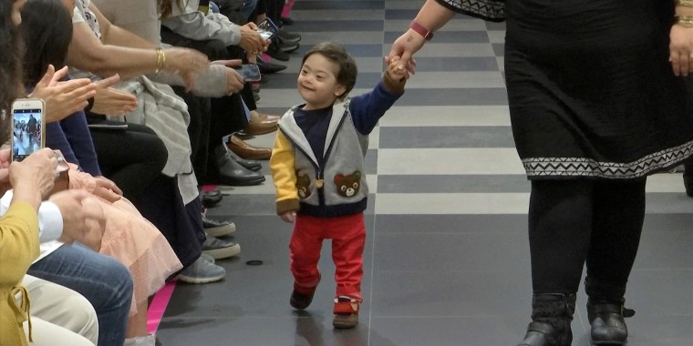 """A young boy participating in the 2nd annual """"Gigi's Playhouse Fashion Show"""" in New York."""