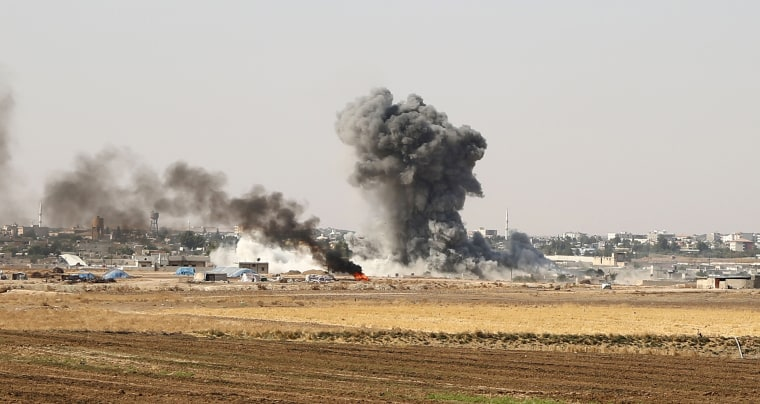 Smoke billows from the Syrian border town of Ras al-Ain