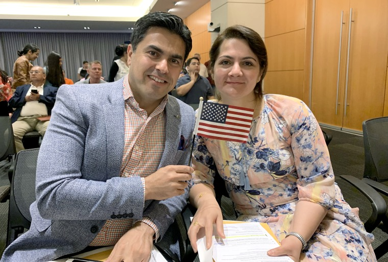 Yerevan Adham and his wife, Hawjeen Qadir, at their U.S. naturalization ceremony in Alexandria, Va., in 2019.