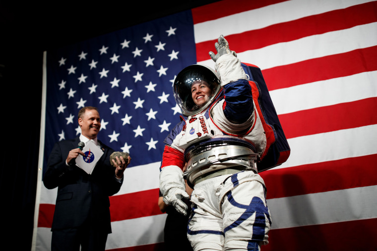 Image: NASA Administrator Jim Bridenstine introduces NASA advance space suit engineer Kristine Davis as she demonstrates the prototype exploration extravehicular mobility unit at NASA Headquarters in Washington on Tuesday, Oct. 15, 2019. (Ting Shen/The Ne