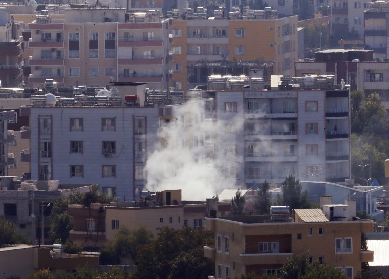 Image: Smoke billows from targets in Ras al-Ayn, Syria, caused by shelling by Turkish forces