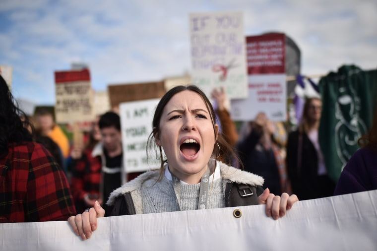 Image: Abortion-rights demonstrators march through the streets of Belfast ahead of a meeting of the Stormont Assembly on abortion rights and gay marriage