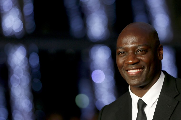 Image: Adewale Akinnuoye-Agbaje arrives for a screening in London in 2015.